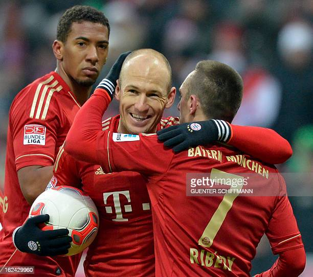 Bayern Munich's Dutch midfielder Arjen Robben and French midfielder Franck Ribery celebrate after the German first division Bundesliga football match...