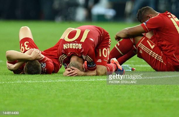 Bayern Munich's Dutch midfielder Arjen Robben and team mate react after loosing the UEFA Champions League final football match between FC Bayern...