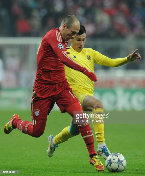 Bayern Munich's Dutch midfielder Arjen Robben and Villarreal's Dutch midfielder Hernan Perez vie for the ball during the Champions League Group A...