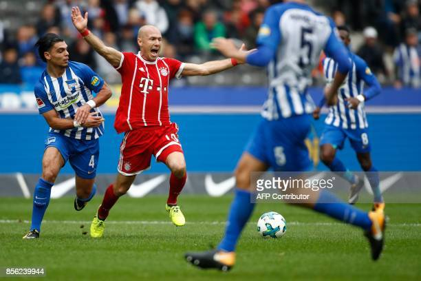 Bayern Munich's Dutch midfielder Arjen Robben appeals for a foul by Berlin's Dutch defender Karim Rekik during the German first division Bundesliga...