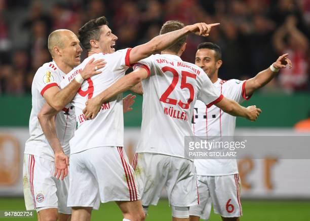 Bayern Munich's Dutch midfielder Arjen Robben Bayern Munich's Polish forward Robert Lewandowski Bayern Munich's German forward Thomas Mueller and...