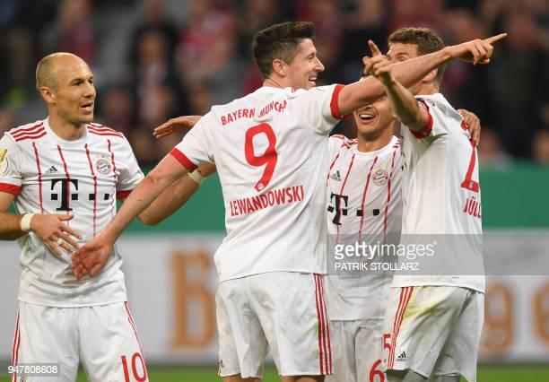 Bayern Munich's Dutch midfielder Arjen Robben Bayern Munich's Polish forward Robert Lewandowski Bayern Munich's Spanish midfielder Thiago Alcantara...