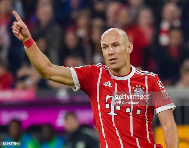 Bayern Munich's Dutch midfielder Arjen Robben celebrates after scoring the 20 during the German First division Bundesliga football match FC Bayern...