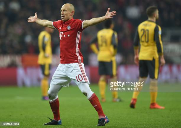 Bayern Munich's Dutch midfielder Arjen Robben celebrates after the first goal during the UEFA Champions League round of sixteen football match...