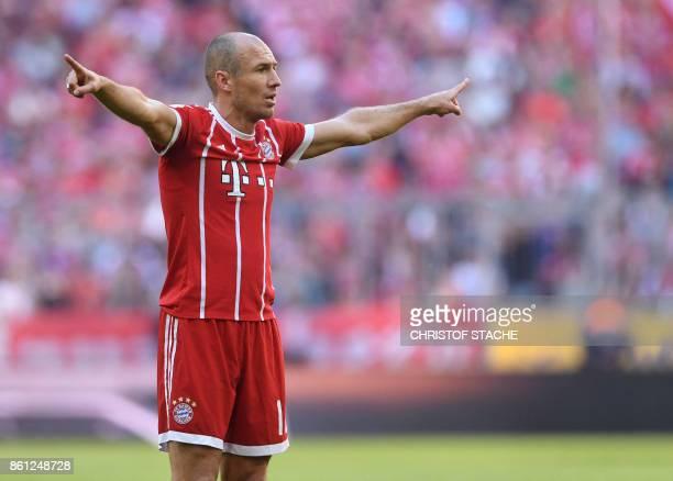 Bayern Munich's Dutch midfielder Arjen Robben celebrates after the third goal for Munich during the German First division Bundesliga football match...