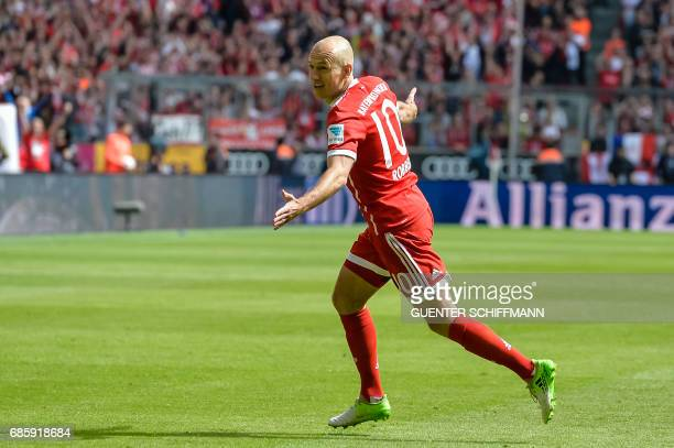 Bayern Munich's Dutch midfielder Arjen Robben celebrates his first goal during the German First division Bundesliga football match Bayern Munich vs...