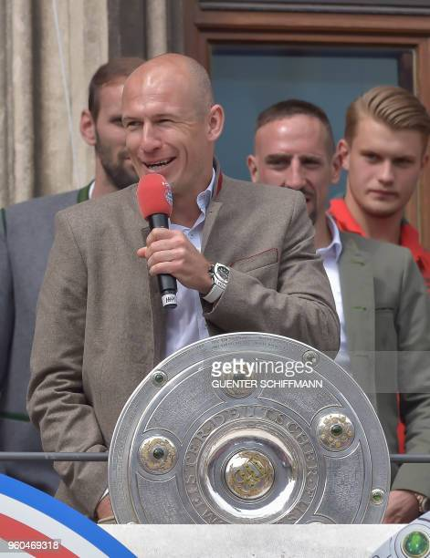Bayern Munich's Dutch midfielder Arjen Robben celebrates on the balcony of the city hall in Munich southern Germany on May 20 2018