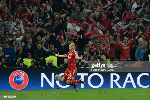 Bayern Munich's Dutch midfielder Arjen Robben celebrates scoring his team's second goal during the UEFA Champions League final football match between...