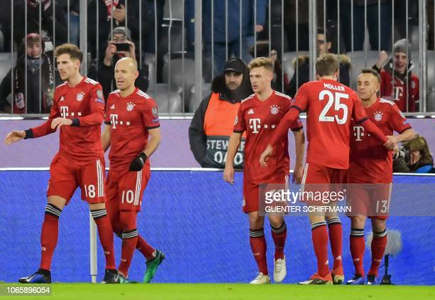 Bayern Munich's Dutch midfielder Arjen Robben celebrates scoring the opening goal with his teammates during the UEFA Champions League Group E...
