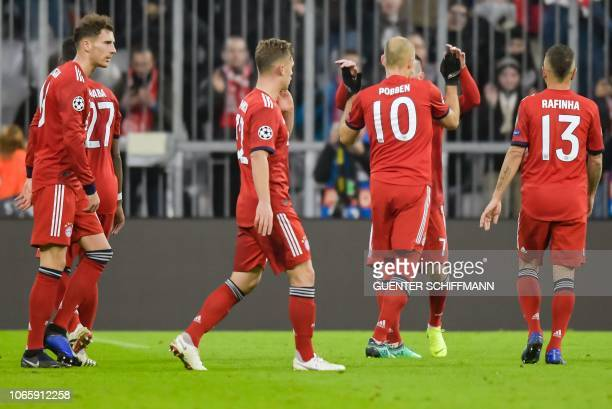 Bayern Munich's Dutch midfielder Arjen Robben celebrates scoring the 20 goal with his teammates during the UEFA Champions League Group E football...