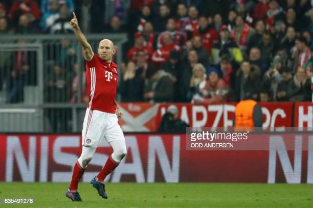 Bayern Munich's Dutch midfielder Arjen Robben celebrates scoring the opening goal during the UEFA Champions League round of sixteen football match...