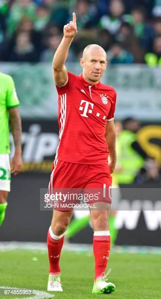 Bayern Munich's Dutch midfielder Arjen Robben celebrates scoring the 40 during the German first division Bundesliga football match between VfL...