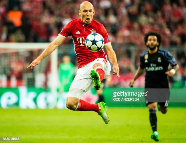 Bayern Munich's Dutch midfielder Arjen Robben controls the ball during the firstleg quarter final Champions league football match between Bayern...