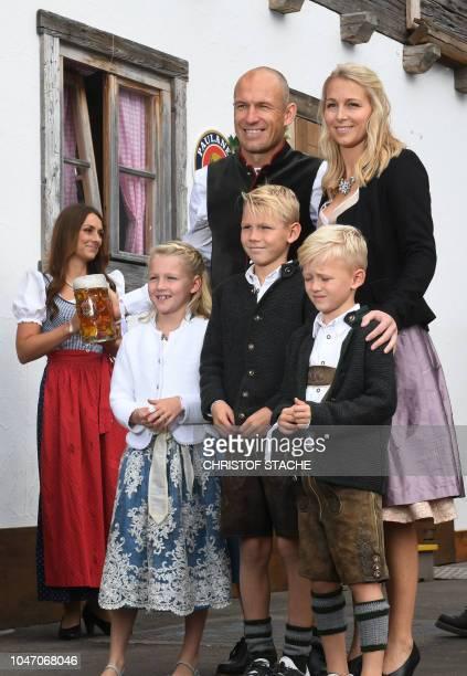 Bayern Munich's Dutch midfielder Arjen Robben his wife Bernadien Robben and their children Lynn Robben Luka Robben and Kai Robben wear traditional...