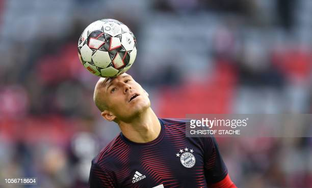 TOPSHOT Bayern Munich's Dutch midfielder Arjen Robben juggles with the ball during the warm up prior the German first division Bundesliga match...