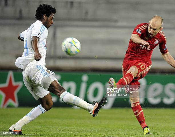 Bayern Munich's Dutch midfielder Arjen Robben kicks the ball in front of Marseille's Cameroonian defender Nicolas Nkoulou during the UEFA Champions...