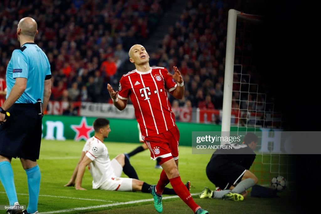 Bayern Munich's Dutch midfielder Arjen Robben reacts after a missed opportunity during the UEFA Champions League quarter-final second leg football match between Bayern Munich and Sevilla FC on April 11, 2018 in Munich, southern Germany. / AFP PHOTO / Odd ANDERSEN