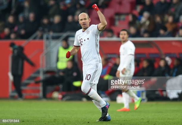 Bayern Munich's Dutch midfielder Arjen Robben reacts after his goal for Munich during the German First division Bundesliga football match between FC...