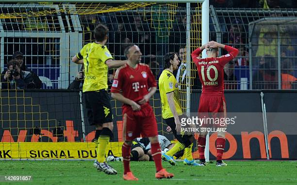 Bayern Munich's Dutch midfielder Arjen Robben reacts after missing a penalty during the German first division Bundesliga football match Borussia...