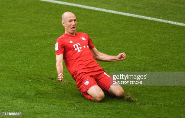 Bayern Munich's Dutch midfielder Arjen Robben reacts after scoring during the German First division Bundesliga football match FC Bayern Munich v...