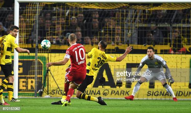 Bayern Munich´s Dutch midfielder Arjen Robben scores against Dortmund's Swiss goalkeeper Roman Buerki during the German First division Bundesliga...