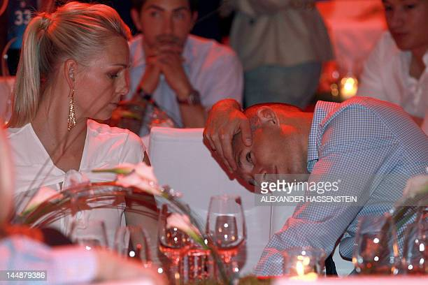 Bayern Munich's Dutch midfielder Arjen Robben sits with his wife Bernadien Robben during the FC Bayern Muenchen after party on May 20 2012 in Munich...