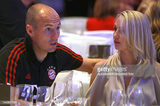 Bayern Munich's Dutch midfielder Arjen Robben speaks with his wife Bernadien Robben during an event of Bayern Munich in Berlin on May 13 2012 The...