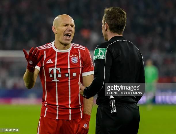 Bayern Munich's Dutch midfielder Arjen Robben talks with Referee Tobias Stieler during the German first division Bundesliga football match FC Bayern...