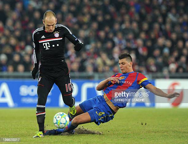 Bayern Munich's Dutch midfielder Arjen Robben vies with Basel's midfielder Granit Xhaka during the UEFA Champions League round of 16 first leg...
