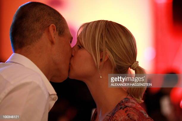 Bayern Munich's Dutch striker Arjen Robben is kissed by his wife Bernadien as they attend a party after the UEFA Champions League final football...