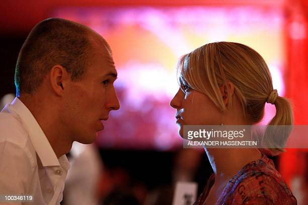 Bayern Munich's Dutch striker Arjen Robben speaks with his wife Bernadien as they attend a party after the UEFA Champions League final football match...