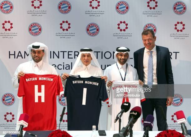 FC Bayern Munich's Executive Board Member Andreas Jung stands next to Hassan alThawadi Secretary General of the Qatar 2022 Supreme Committee and...