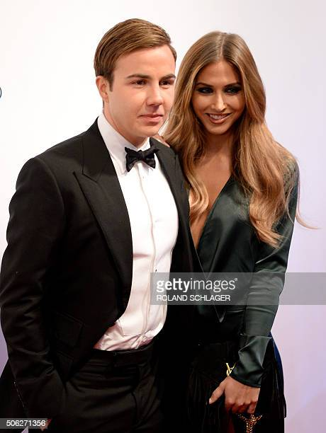 Bayern Munich's football player Mario Goetze and model AnnKathrin Brömmel pose upon arrival at the 'Audi Night' in Kitzbuehel Austria on January 22...