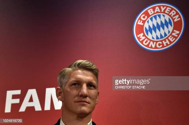 Bayern Munich's former midfielder Bastian Schweinsteiger looks on during an event to unveil his new Hall of fame star at the Bayern's museum...