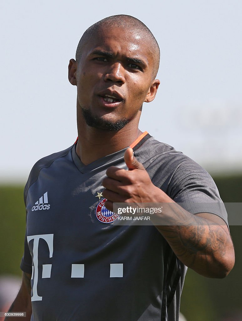 Bayern Munich's forward Douglas Costa takes part in a training session at the Aspire Academy in Doha on January 4, 2017. Bayern Munich is training at the Aspire Academy in Doha for a week. / AFP / KARIM