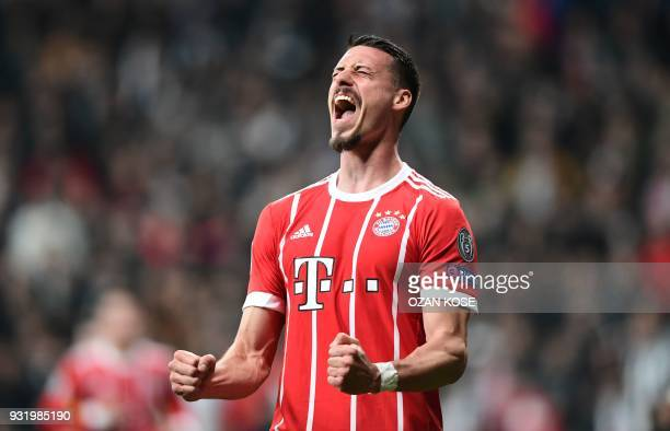TOPSHOT Bayern Munich's forward Sandro Wagner celebrates after scoring during the second leg of the last 16 UEFA Champions League football match...