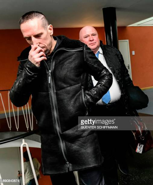Bayern Munich's Franck Ribery and his attorney Carlo Brusa leave the courtroom after the court hearing on a case filed by his former agent Bruno...