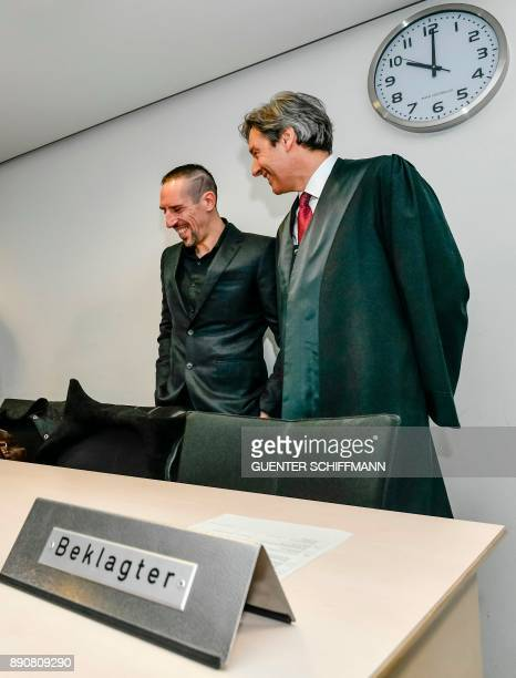 Bayern Munichs Franck Ribery and his lawyer Gerhard Riedl arrive at court for a case filed by his former agent Bruno Heiderscheid who is claiming 35...
