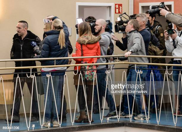 Bayern Munich's Franck Ribery is followed by journalists as he leaves the courtroom after the court hearing on a case filed by his former agent Bruno...