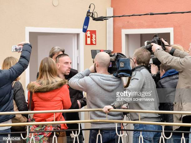 Bayern Munich's Franck Ribery is surrounded by journalists as he leaves the courtroom after the court hearing on a case filed by his former agent...