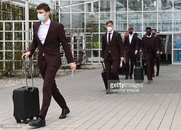 Bayern Munich's French defender Benjamin Pavard and other Bayern Munich players leave the airport upon arrival in Munich, southern Germany, on April...