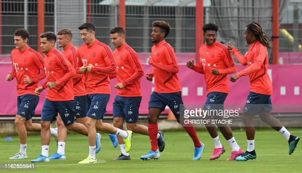 Bayern Munich's French defender Benjamin Pavard Bayern Munich's Brazilian midfielder Philippe Coutinho Bayern Munich's French midfielder Mickael...