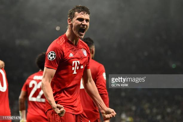 TOPSHOT Bayern Munich's French defender Benjamin Pavard celebrates after Bayern Munich's Polish forward Robert Lewandowski scores their second goal...
