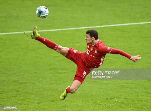 Bayern Munich's French defender Benjamin Pavard plays the ball during the German first division Bundesliga football match between FC Bayern Munich...