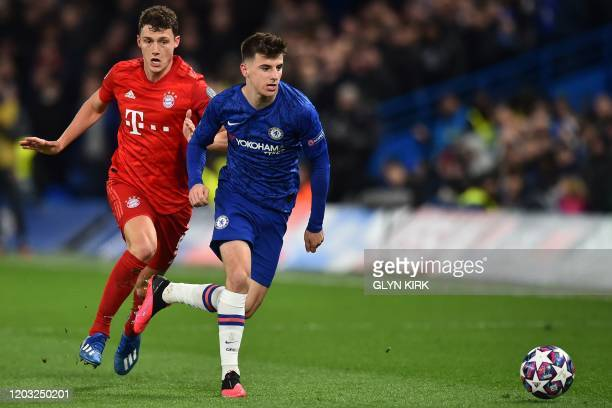 Bayern Munich's French defender Benjamin Pavard trips Chelsea's English midfielder Mason Mount during the UEFA Champion's League round of 16 first...