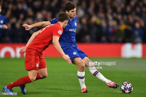 Bayern Munich's French defender Benjamin Pavard vies with Chelsea's Spanish defender Marcos Alonso during the UEFA Champion's League round of 16...