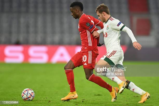 Bayern Munich's French defender Bouna Sarr and Lokomotiv Moscow's Russian midfielder Dmitri Rybchinskiy vie for the ball during the UEFA Champions...