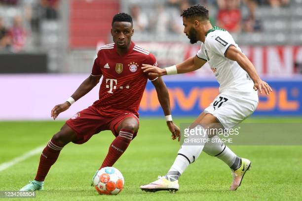 Bayern Munich's French defender Bouna Sarr and Moenchengladbach's English forward Keanan Bennetts vie for the ball during the Audi Summer Tour 2021...