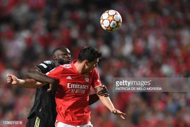 Bayern Munich's French defender Dayot Upamecano vies with Benfica's Ukrainian forward Roman Yaremchuk during the UEFA Champions League Group E...