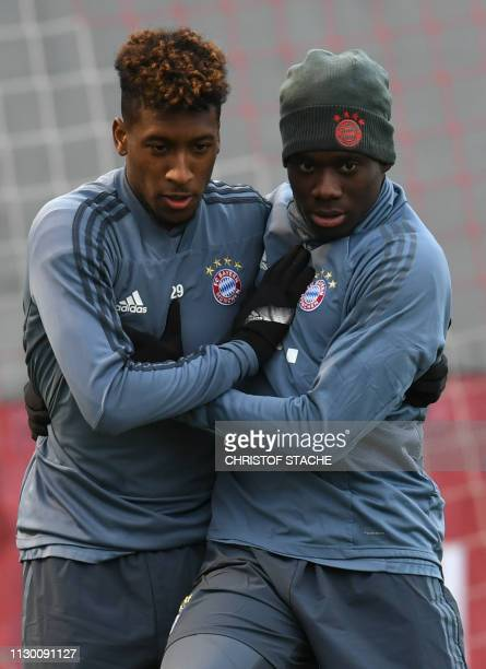 Bayern Munich's French defender Kingsley Coman and Bayern Munich's midfielder Alphonso Davies joke during the training session on the eve of their...